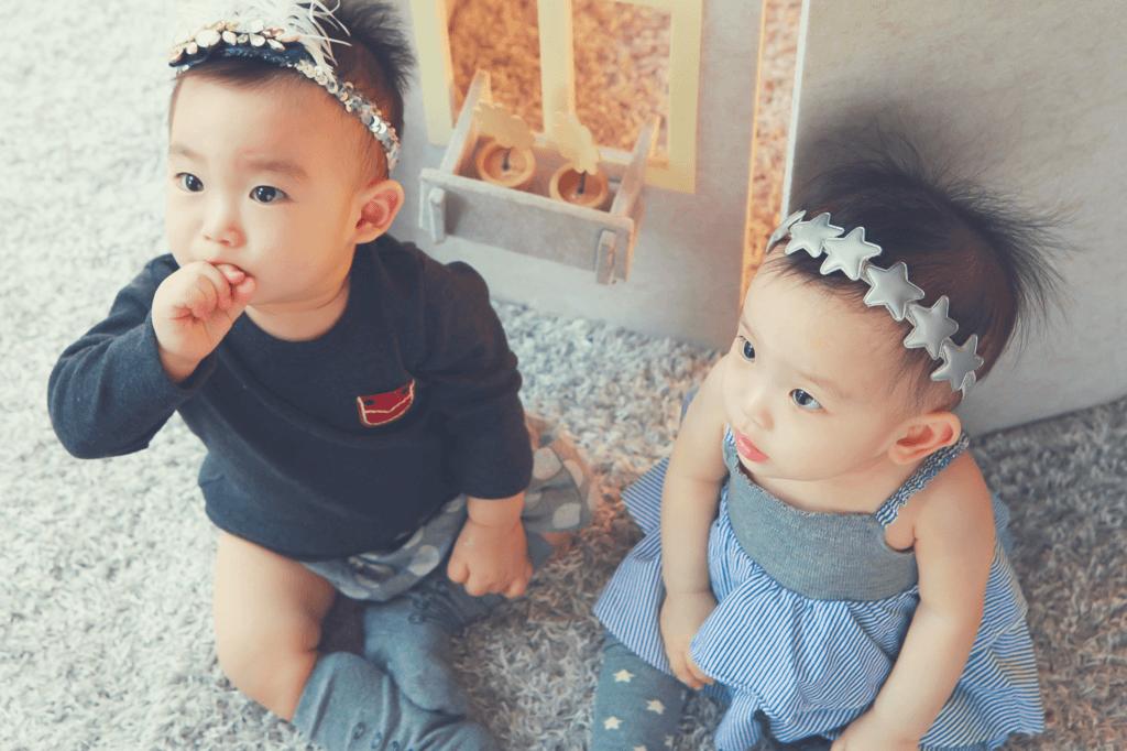 twins sitting on floor