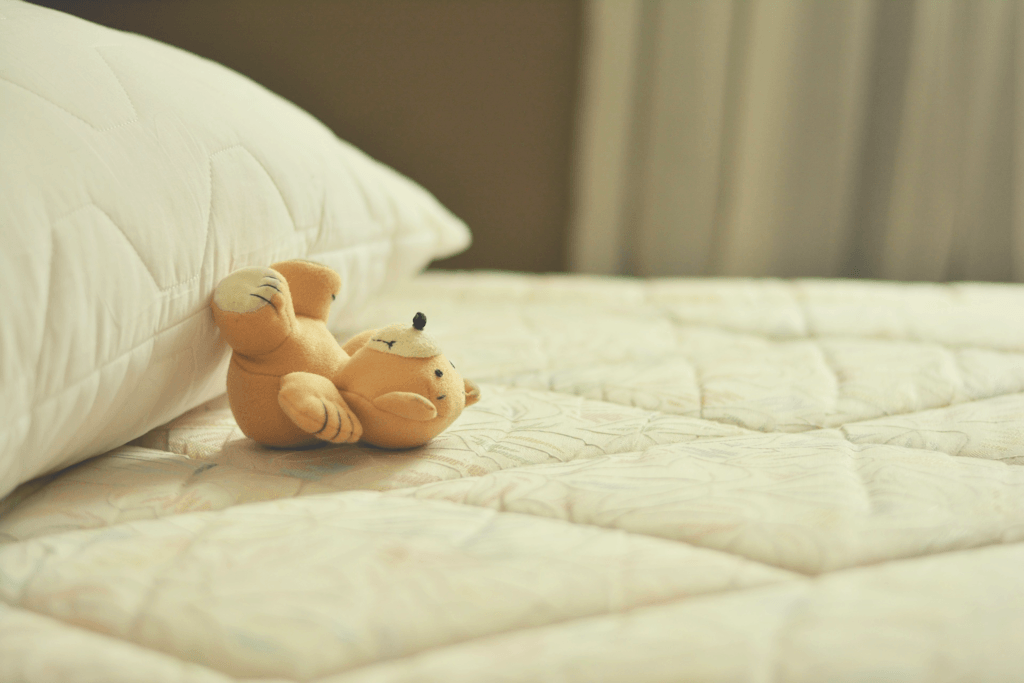 bed with stuffed animal