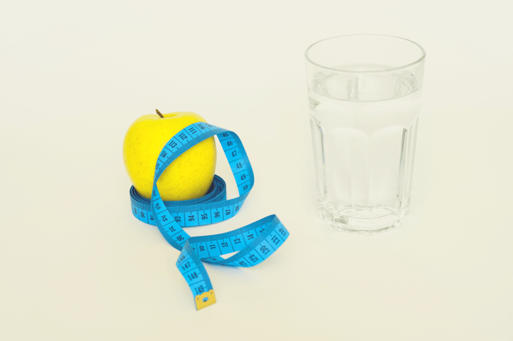 apple, water, and measuring tape