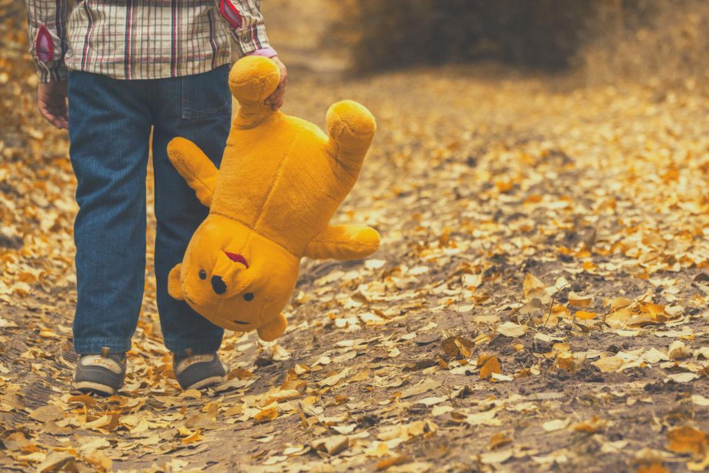 child with stuffed animal bear