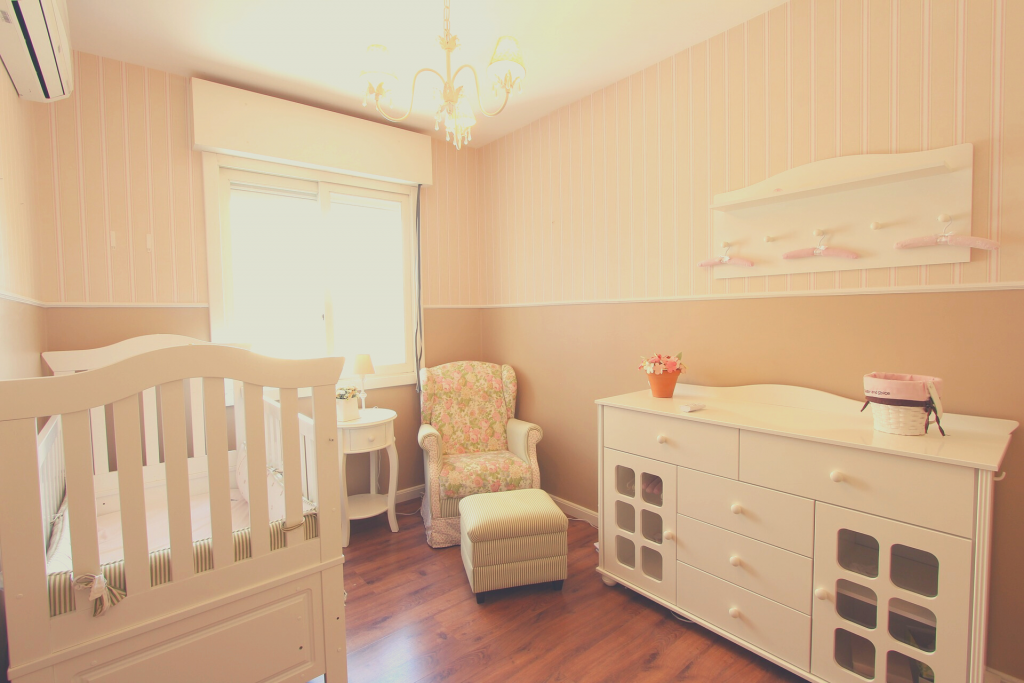 baby nursery with glider
