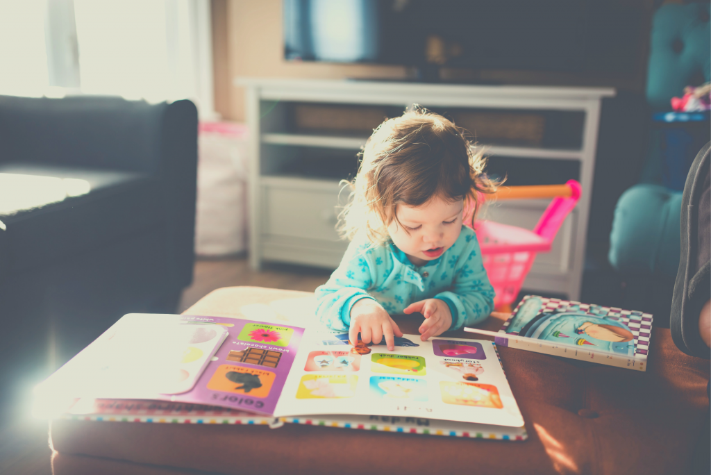 toddler with a book