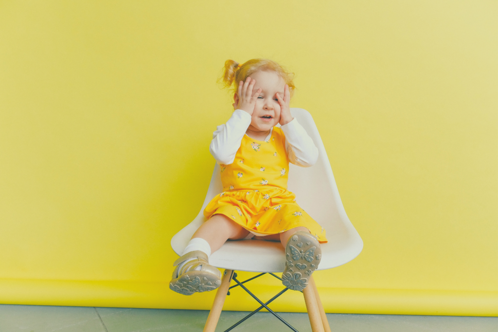 toddler in a chair
