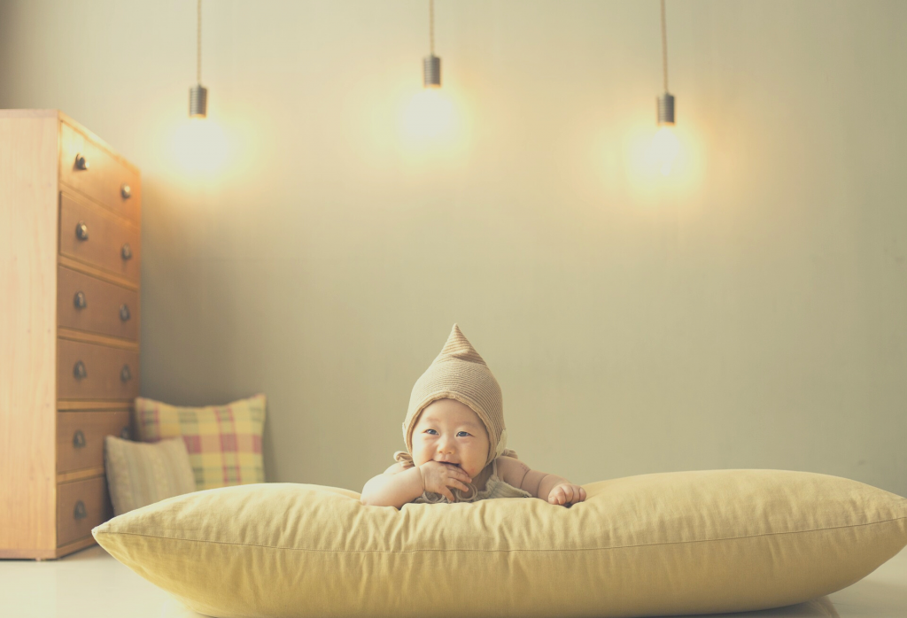 toddler on a pillow
