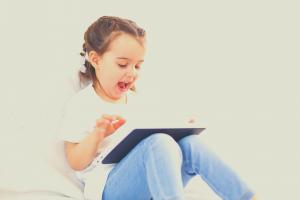 girl reading on tablet