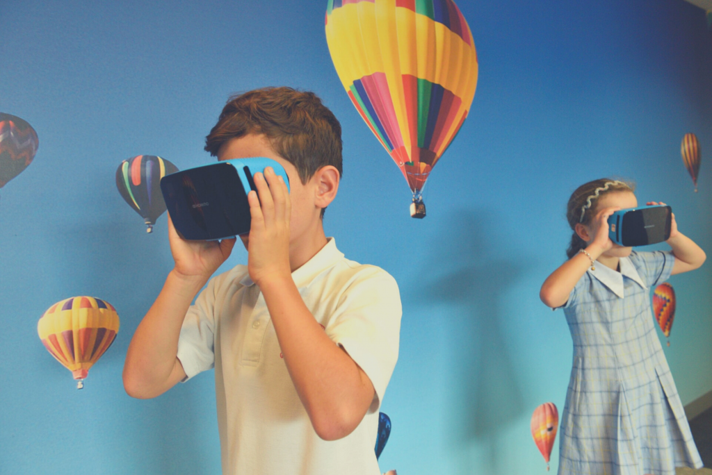 kids wearing virtual reality headset