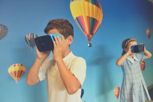 kids wearing virtual reality headset