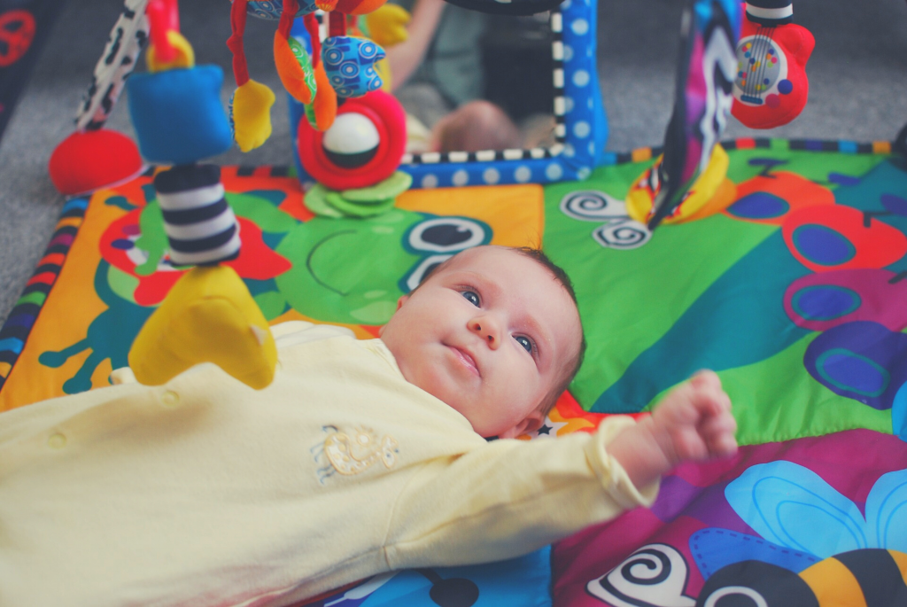 baby playing on play mat