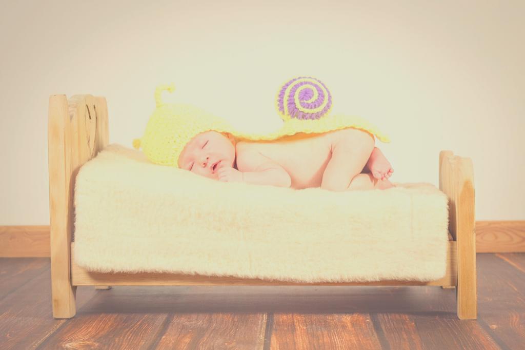 baby sleeping on baby bed
