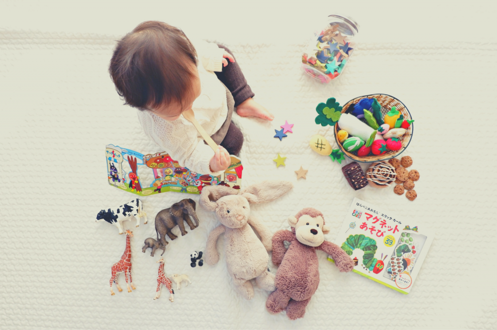 baby surrounded by toys