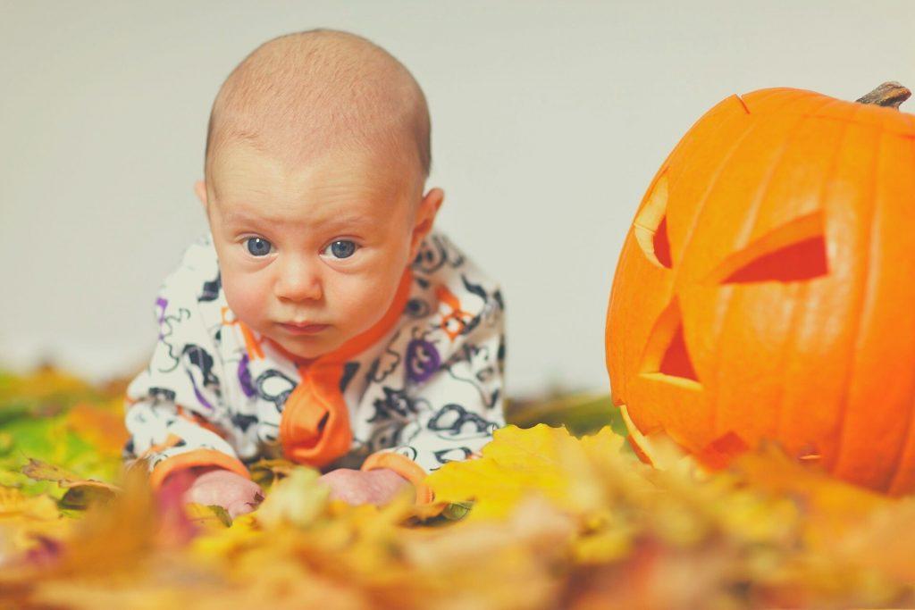 bbay and a pumpkin
