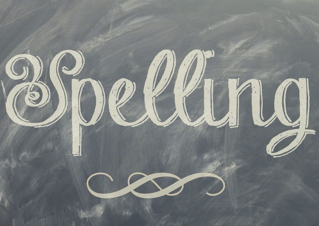 spelling written on blackboard