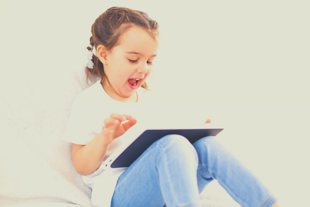 girl learning on tablet