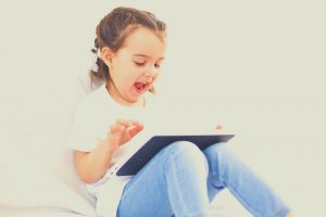 girl learning on tablet